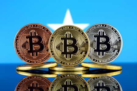 Physical version of Bitcoin (BTC) and Somalia Flag. Conceptual image for investors in High Technology (Cryptocurrency, Blockchain Technology, Smart Contracts, ICO).