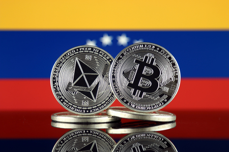 Physical version of Ethereum (ETH), Bitcoin (BTC) and Venezuela Flag. 2 largest cryptocurrencies in terms of market capitalization. Stock Photo