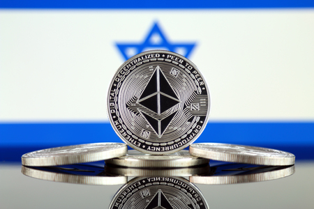 Physical version of Ethereum (ETH) and Israel Flag. Conceptual image for investors in cryptocurrency, Blockchain Technology, Smart Contracts, Personal Tokens and Initial Coin Offering.