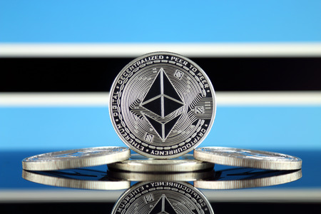 Physical version of Ethereum (ETH) and Botswana Flag. Conceptual image for investors in cryptocurrency, Blockchain Technology, Smart Contracts, Personal Tokens and Initial Coin Offering.