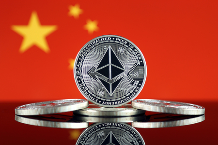Physical version of Ethereum (ETH) and China Flag. Conceptual image for investors in cryptocurrency, Blockchain Technology, Smart Contracts, Personal Tokens and Initial Coin Offering. Фото со стока