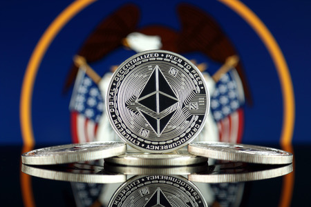 Physical version of Ethereum (ETH) and Utah State Flag. Conceptual image for investors in cryptocurrency, Blockchain Technology, Smart Contracts, Personal Tokens and Initial Coin Offering. Stock Photo