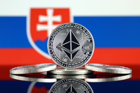 Physical version of Ethereum (ETH) and Slovakia Flag. Conceptual image for investors in cryptocurrency, Blockchain Technology, Smart Contracts, Personal Tokens and Initial Coin Offering.