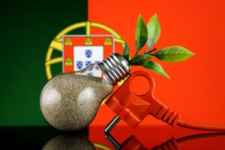 Plug, plant growing inside the light bulb and Portugal Flag. Green eco renewable energy concept.
