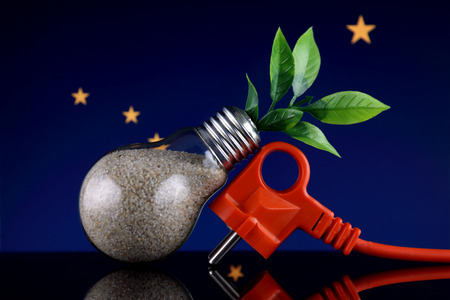 Plug, plant growing inside the light bulb and Alaska State Flag. Green eco renewable energy concept. 版權商用圖片