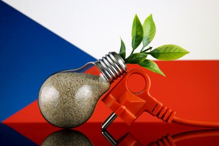 Plug, plant growing inside the light bulb and Czech Republic Flag. Green eco renewable energy concept.
