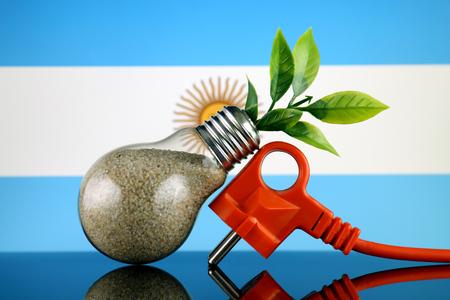 Plug, plant growing inside the light bulb and Argentina Flag. Green eco renewable energy concept. Stock fotó