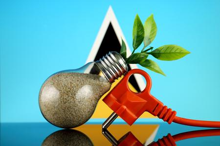 Plug, plant growing inside the light bulb and Saint Lucia Flag. Green eco renewable energy concept.