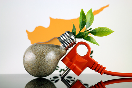 Plug, plant growing inside the light bulb and Cyprus Flag. Green eco renewable energy concept.