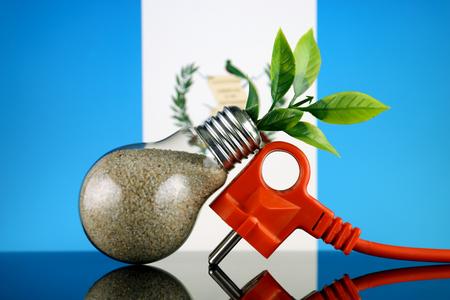 Plug, plant growing inside the light bulb and Guatemala Flag. Green eco renewable energy concept. Stock fotó