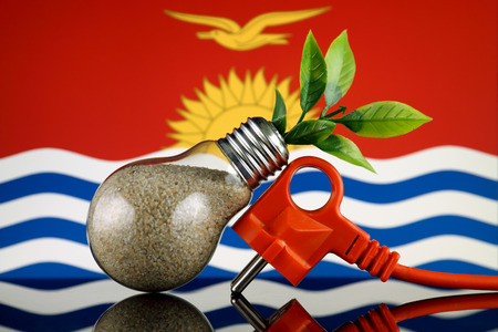 Plug, plant growing inside the light bulb and Kiribati Flag. Green eco renewable energy concept. 免版税图像