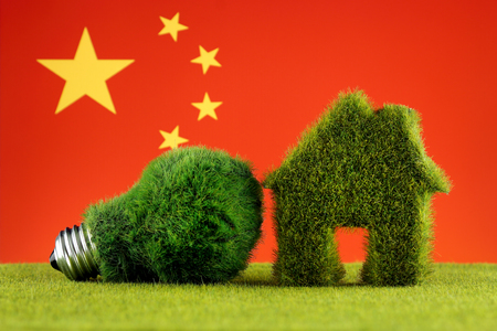 Green eco light bulb, eco house icon and China Flag. Renewable energy. Electricity prices, energy saving in the household.