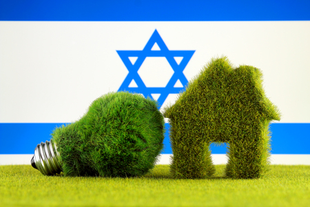 Green eco light bulb, eco house icon and Israel Flag. Renewable energy. Electricity prices, energy saving in the household.