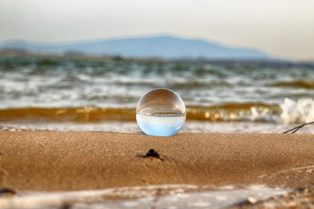 Mietkow Lake, Poland. Wild, untouched nature. View through a glass, crystal ball for refraction photography.