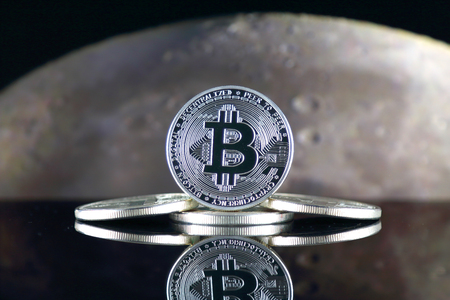 Bitcoin (BTC) and the moon. The saying TO THE MOON suggests an increase in the value of cryptocurrencies. Archivio Fotografico