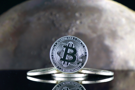 Bitcoin (BTC) and the moon. The saying TO THE MOON suggests an increase in the value of cryptocurrencies.