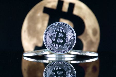 Bitcoin (BTC) and the moon. The saying TO THE MOON suggests an increase in the value of cryptocurrencies. Stock fotó