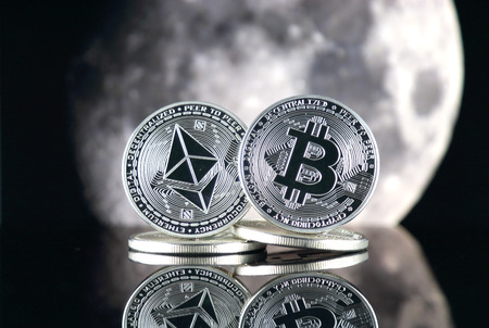 Bitcoin (BTC), Ethereum (ETH) and the moon. The saying TO THE MOON suggests an increase in the value of cryptocurrencies.