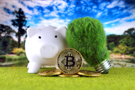 Bitcoin (BTC) and green, renewable energy concept. Electricity prices, energy saving in the cryptocurrency mining business.