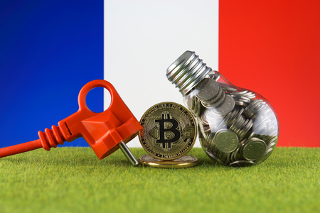 Bitcoin (BTC), green renewable energy concept, and France Flag. Electricity prices, energy saving in the cryptocurrency mining business. Imagens