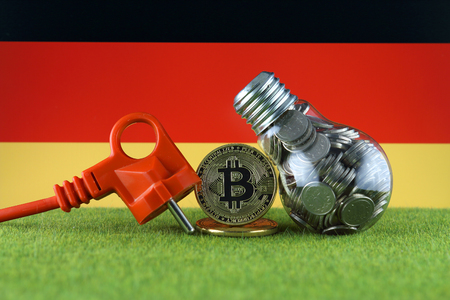 Bitcoin (BTC), green renewable energy concept, and Germany Flag. Electricity prices, energy saving in the cryptocurrency mining business. Zdjęcie Seryjne