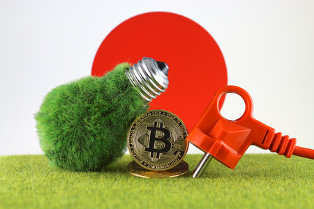Bitcoin (BTC), green renewable energy concept, and Japan Flag. Electricity prices, energy saving in the cryptocurrency mining business.