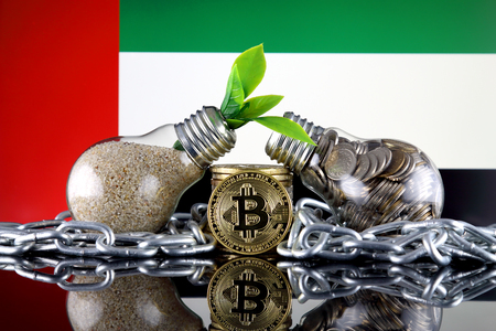 Bitcoin (BTC), green renewable energy concept, and United Arab Emirates Flag. Electricity prices, energy saving in the cryptocurrency mining business. 写真素材