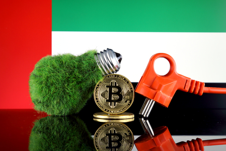 Bitcoin (BTC), green renewable energy concept, and United Arab Emirates Flag. Electricity prices, energy saving in the cryptocurrency mining business. Standard-Bild