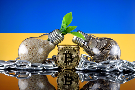 Bitcoin (BTC), green renewable energy concept, and Ukraine Flag. Electricity prices, energy saving in the cryptocurrency mining business.