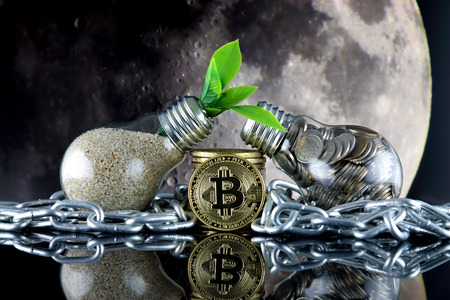 Bitcoin (BTC), the moon and green, renewable energy concept. Electricity prices in the cryptocurrency mining business. The saying TO THE MOON suggests an increase in the value of cryptocurrencies.