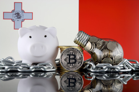 Bitcoin (BTC), Blockchain Technology, energy concept and Malta Flag. Electricity prices, energy saving in the cryptocurrency mining business.