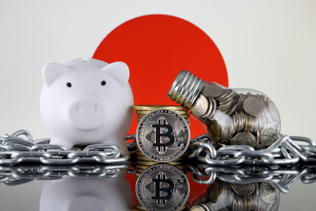 Bitcoin (BTC), Blockchain Technology, energy concept and Japan Flag. Electricity prices, energy saving in the cryptocurrency mining business.