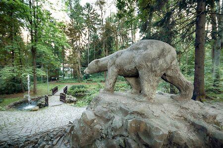 POLANICA ZDROJ, POLAND - AUGUST 26, 2019: The spa park in the center of Polanica Zdroj, Lower Silesia, south-western Poland. Bear Monument.