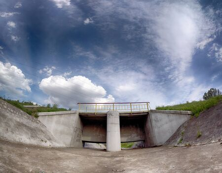 The water dam in Wroclaw, Poland in the last days of September. Beautiful storm clouds and sunbeams.