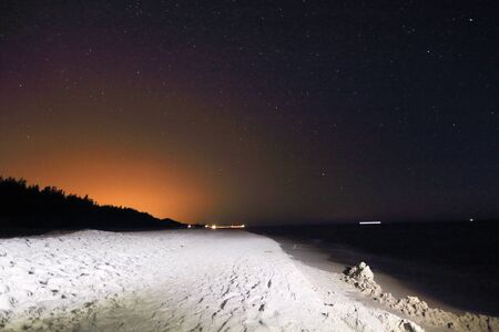 Slowinski National Park on the Baltic Sea coast, near Leba, Poland. Night view, starry sky right after the moon rising. Beautiful sandy beaches and coastal landscape. Stok Fotoğraf