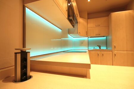 Modern luxury kitchen with custom made furnishings and LED RGB backlit glass