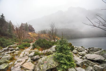 Tatra National Park in Polish High Tatra Mountains. Lake Morskie Oko (Eye of the Sea Lake) on a foggy and rainy day, Zakopane, Poland, Europe.
