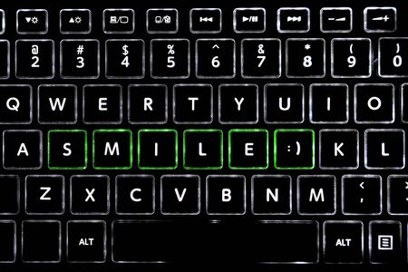 Word SMILE written with LED backlit keyboard buttons.