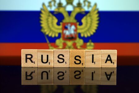 Russia Flag and country name made of small wooden letters. Studio shot. Reklamní fotografie