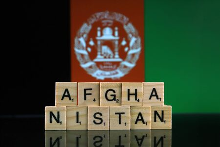 Afghanistan Flag and country name made of small wooden letters. Studio shot.