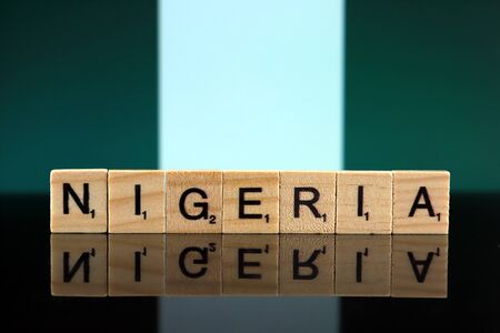 Nigeria Flag and country name made of small wooden letters. Studio shot.