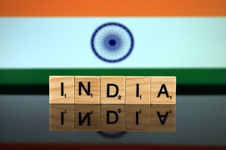 India Flag and country name made of small wooden letters. Studio shot.