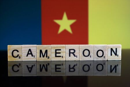 Cameroon Flag and country name made of small wooden letters. Studio shot. Imagens