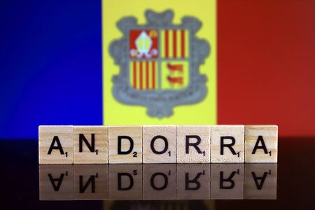 Andorra Flag and country name made of small wooden letters. Studio shot.