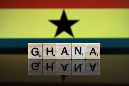 Ghana Flag and country name made of small wooden letters. Studio shot.