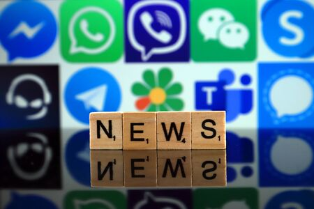WROCLAW, POLAND - FEBRUARY 19, 2020: Word NEWS made of wooden letters, and MESSENGER, WHATSAPP, VIBER, WECHAT, SKYPE, TEAMSPEAK, TELEGRAM, ICQ, MICROSOFT TEAMS, SIGNAL logos in the background.