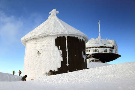 KARPACZ, POLAND - MARCH 08, 2020: St. Lawrence's Chapel in the Winter. A Roman Catholic chapel located on the peak of Sniezka mountain (1602 m. above sea level), Giant Mountains, Poland, Europe. Editorial