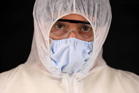 Doctor in a protective suit and mask during a rapidly spreading coronavirus. Global coronavirus disease (COVID-19) 2020.