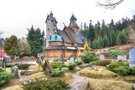 KARPACZ, POLAND - MARCH 09, 2020: Old wooden temple Vang (Wang). Medieval Norwegian stave church which was transferred from Vang in Norway and re-erected in 1842 in Karpacz, Poland, Europe.