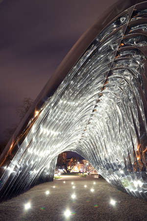 WROCLAW, POLAND - MARCH 10, 2020: Night view of the NAWA sculpture designed by Oskar Zieta, erected on Daliowa Island. Due to polished steel surface NAWA reflects its surroundings.